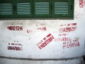 stencilled phone numbers on the streets of Hanoi