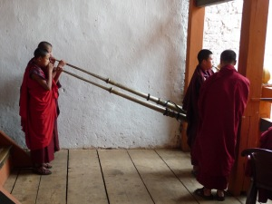 Monks playing traditional Bhutanese instruments